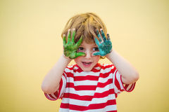 Boy holding his paint covered hands up Royalty Free Stock Photography