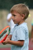 Boy holding his racket Royalty Free Stock Image