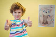 Boy holding his thumbs up Royalty Free Stock Photos