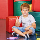 Boy holding his thumbs up in kindergarten Royalty Free Stock Images