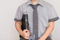 Boy Holding Holy Bible Stock Images