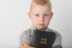 Boy Holding Holy Bible Royalty Free Stock Photography