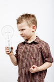 Boy holding huge bulb Royalty Free Stock Images