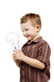 Boy holding huge bulb Royalty Free Stock Image