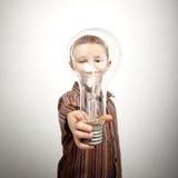 Boy holding huge bulb Stock Photos