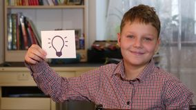Boy Holding Idea Bulb stock footage