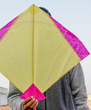 Boy holding an indian paper kite. Used in the sport of kite fighting on Makar Sankranti Stock Images