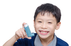 Boy holding inhaler and smile Stock Images