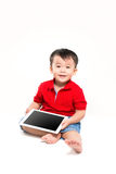 Boy holding ipad Royalty Free Stock Photos