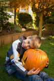 Boy holding jack-o-lantern from big pumpkin Stock Photography