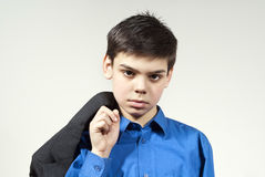 Boy holding a jacket Stock Photo
