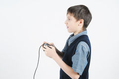 A boy holding a joystick Royalty Free Stock Photos
