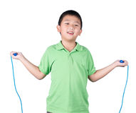 Boy holding a jump rope isolated on white background Royalty Free Stock Image