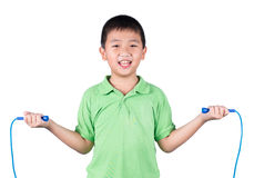 Boy holding a jump rope isolated on white background Stock Photo