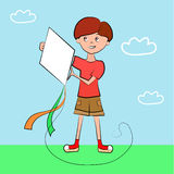 Boy holding a kite against the sky Stock Photography