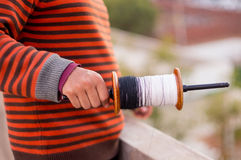 Boy holding a kite flying spool. On the festival of maker sankrnati. With a soft out of focus background Stock Photo