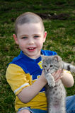 Boy holding kitten Royalty Free Stock Images