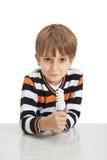 Boy holding a lamp Stock Photo