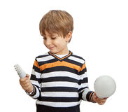 Boy holding a lamp Royalty Free Stock Photos