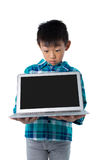 Boy holding laptop Royalty Free Stock Images