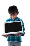 Boy holding laptop against white background Royalty Free Stock Photography