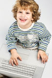 Boy holding laptop and smiling Royalty Free Stock Image