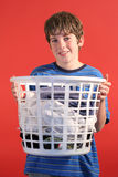 Boy holding laundry Royalty Free Stock Photography