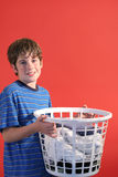 Boy holding laundry Royalty Free Stock Image