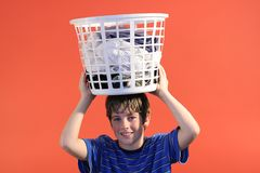 Boy holding laundry Stock Photo