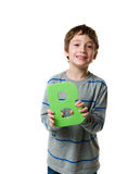 Boy holding the letter B Stock Image