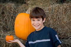 Boy Holding a Little Pumpkin Stock Images