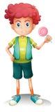 A boy holding a lollipop Stock Photography
