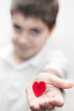 Boy holding love heart valentine's Stock Image