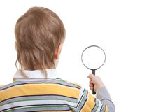 Boy holding magnifying glass Royalty Free Stock Photo