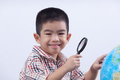 Boy holding magnifying glass Stock Photography
