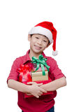 Boy holding many present boxes and smiles Royalty Free Stock Images