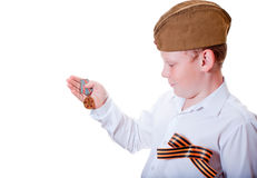 The boy is holding a medal. On a white background Stock Images