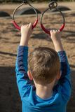 A Boy Holding Metal Rings stock images
