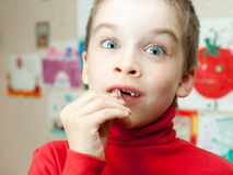 Boy holding missing teeth Stock Photo