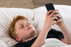 Boy Holding Mobile Phone Stock Image