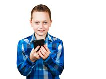 Boy holding mobile phone and smiles, Isolated on white background royalty free stock photo