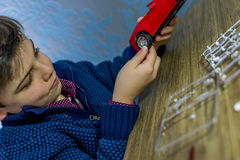 Boy holding model car Royalty Free Stock Images