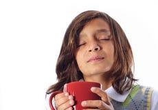 Boy Holding a Mug Royalty Free Stock Images