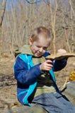 Boy holding a mushroom tinder royalty free stock images