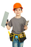 Boy holding notched and spatula Royalty Free Stock Image