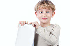 Boy holding notebook isolated Royalty Free Stock Photography