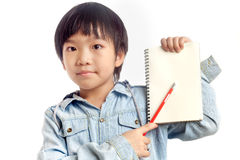 Boy holding notebook with pencil. Boy holding blank notebook with pencil on white background Royalty Free Stock Image