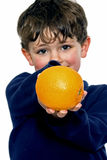 Boy holding orange Royalty Free Stock Photo