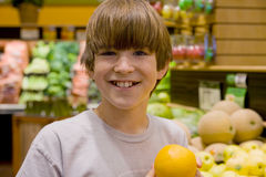 Boy Holding an Orange Stock Photo