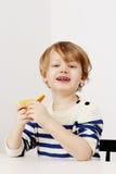 Boy holding orange Royalty Free Stock Photography